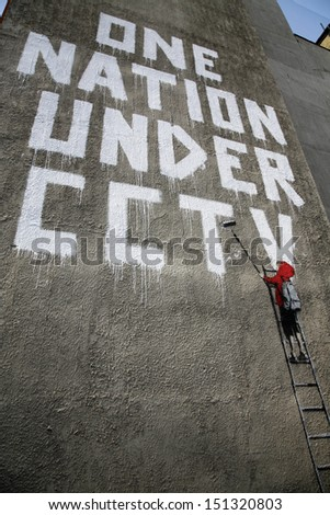 "LONDON, UK - 17TH JUNE 2008: Banksy's ""One Nation Under CCTV"" Graffiti located off of Oxford Street, London. - stock photo"