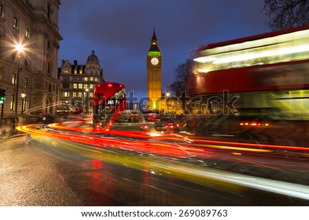 LONDON, UK - 24TH MARCH 2015:  Double Decker Buses, London Taxi and other traffic near Big Ben and Westminster during rush hour - stock photo
