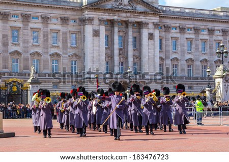 LONDON, UK - 24TH MARCH 2014: The Queens Guards musicians coming out of Buckingham Palace during the Changing of the Guard - stock photo