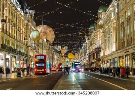 LONDON, UK - 27TH NOVEMBER 2015: A view along Regent Street in London at night during the Christmas Season showing the streets and decorations. Traffic and people can be seen. - stock photo