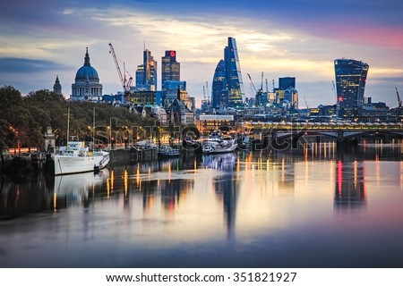 LONDON, UK - 8TH NOVEMBER 2015 : Part of the London Skyline at sunrise showing buildings in central London including, Tower 42 Gherkin,Willis Building, Stock Exchange Tower and Lloyd`s of London. - stock photo