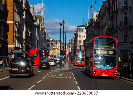 LONDON, UK - 26TH SEPTEMBER 2014: A view down Piccadilly in central London. Buses can people can be seen along the street. - stock photo