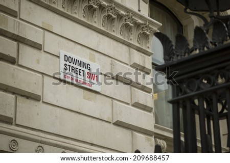 LONDON, UK -  The gate around 10 Downing Street in London, UK on November 6, 2013. British PM David Cameron is working and living in the premise.  - stock photo