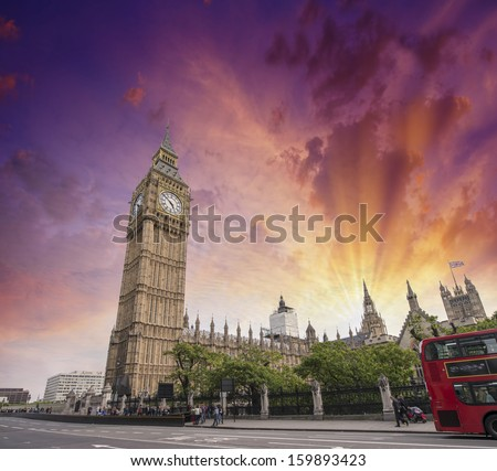 London, UK. Westminster Palace at sunset with red double decker bus speeding up. - stock photo