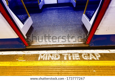 London underground sign, mind tha gap. - stock photo