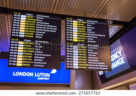 LONDON, UNITED KINGDOM - April 12, 2015: Airport departure board screen at Luton airport in London, UK - stock photo