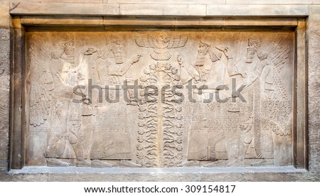 LONDON, UNITED KINGDOM - APRIL 10, 2015: Assyrian's relief in The British Museum. The museum was established in 1753. The museum received a record 6.7 million visitors in 2013. - stock photo