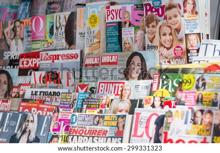 LONDON, UNITED KINGDOM- 1 APRIL 2015: Newsstand found in central London displaying many international titles such as Psychologies Magazine, InStyle, Vogue, Marie Claire and Harperâ??s Bazaar Magazine. - stock photo