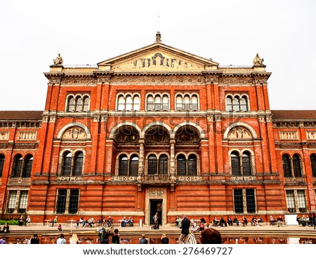 LONDON, UNITED KINGDOM - APRIL 10, 2015: People visiting Victoria and Albert Museum. V&A Museum is the world's largest museum of decorative arts and design founded in 1852. - stock photo