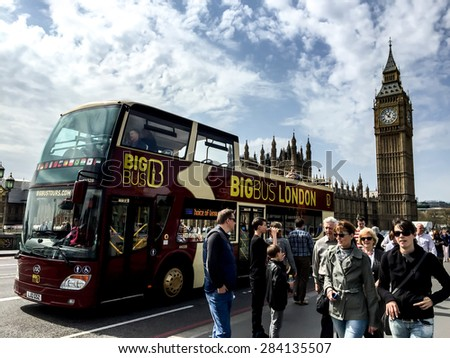LONDON, UNITED KINGDOM - APRIL 16, 2015: Site seeing bus waiting for tourists at Westminster bridge . London is the world's most-visited city as measured by international arrivals. - stock photo