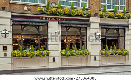 LONDON, UNITED KINGDOM - 26 APRIL, 2015: Typical British pub in London, United Kingdom on 26 April, 2015. Pub business in the UK has been declining every year. - stock photo