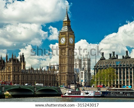 LONDON, UNITED KINGDOM - 26 APRIL, 2015: Typical red bus and black taxi in London, United Kingdom on 26 April, 2015. London is the capital of England. - stock photo