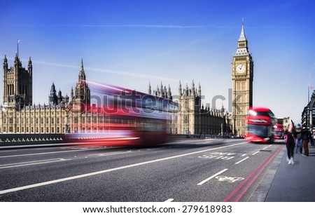 LONDON, UNITED KINGDOM - 12 APRIL, 2015: Typical view on London, United Kingdom with the red bus and the taxi or cab in London on 12 April, 2015. - stock photo