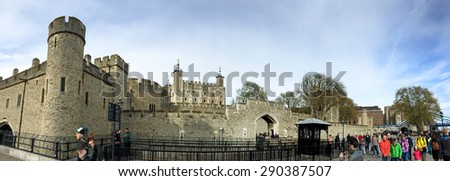 LONDON, UNITED KINGDOM - APRIL 18, 2015: Visitors on queue at London tower entrance. London  is the world's most-visited city as measured by international arrivals. - stock photo
