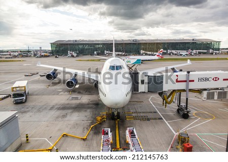LONDON, UNITED KINGDOM - AUGUST 19, 2014: Brithis Airways Boeing 747 at London Heathrow airport with some more aircrafts on background - stock photo