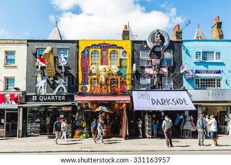 LONDON, UNITED KINGDOM - August 04, 2015: Camden Lock Bridge, famous alternative culture shops on August 4, 2015 in Camden Town, London. Camden Town markets are visited by 100,000 people each weekend - stock photo