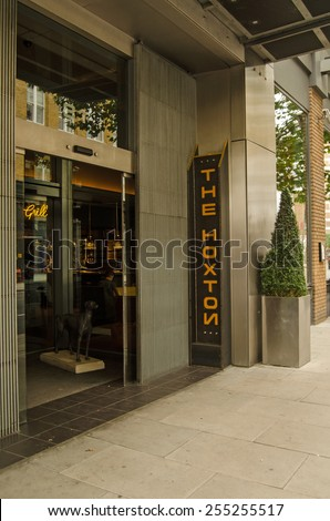 LONDON, UNITED KINGDOM - AUGUST 30, 2014:  Entrance to the trendy boutique hotel The Hoxton in a fashionable part of Hackney in London's East End. - stock photo