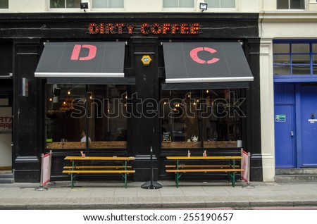 LONDON, UNITED KINGDOM - AUGUST 30, 2014:  Facade of the trendy Dirty Coffee cafe in fashionable Hoxton, East London. - stock photo