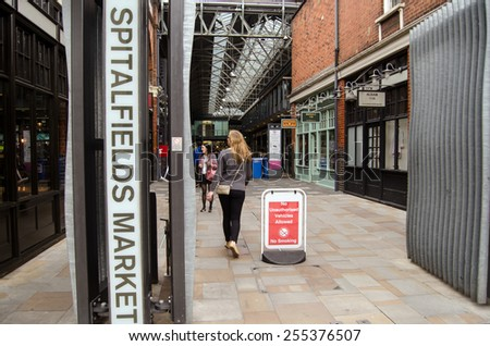 LONDON, UNITED KINGDOM - AUGUST 30, 2014:  Shoppers at the entrance to the trendy Spitalfields Market in Shoreditch, London.  The covered market is famous for fashion and is popular with hipsters. - stock photo