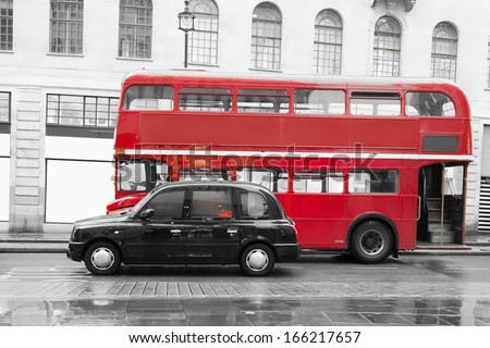 LONDON, UNITED KINGDOM - CIRCA NOVEMBER 2013:Red vintage bus and classic style taxi in London. London City tour - stock photo