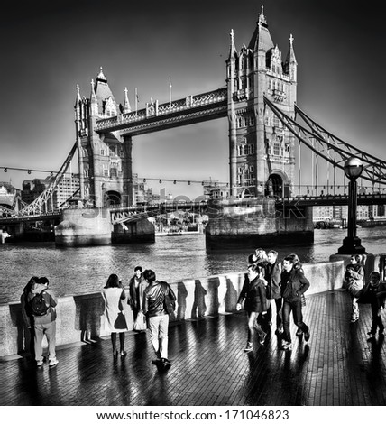LONDON, UNITED KINGDOM - DEC 29: Tower Bridge, the busy iconic River Thames crossing suspension bridge built between 1886 and 1894; December 29, 2013 in London, UK.  - stock photo