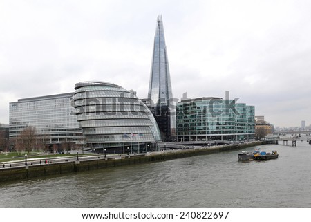 LONDON, UNITED KINGDOM - JANUARY 25: City Hall and The Shard in London on JANUARY 25, 2013. View from Tower Bridge towards City Hall and The Shard skyscraper at Southwark in London, United Kingdom. - stock photo