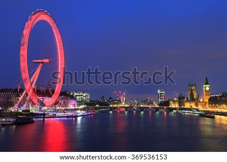 LONDON, UNITED KINGDOM â?? 24 JANUARY 2016: London Eye is the tallest Ferris wheel in Europe, Big Ben and Country Hall in London, United Kingdom - stock photo