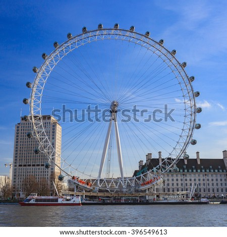 LONDON, UNITED KINGDOM - 22 JANUARY 2016: London Eye is the tallest Ferris wheel in Europe at 135 meters and Country Hall in London, United Kingdom - stock photo