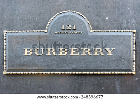 LONDON, UNITED KINGDOM - JULY 1, 2014: Burberry flagship store sign on Regent Street, London. The brand was founded by Thomas Burberry in 1856. - stock photo
