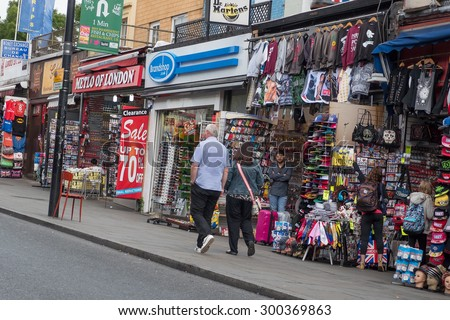 LONDON, UNITED KINGDOM - JUNE 16, 2015: Camden Town Market, famous alternative culture shops in Camden Town, London, England. Camden Town markets are visited by 100,000 people each weekend. - stock photo
