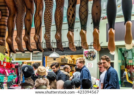 London, United Kingdom - May 14, 2016: Brixton Village and Brixton Station Road Market. Colorful and multicultural community market run by local traders in South London. Tights and stockings - stock photo