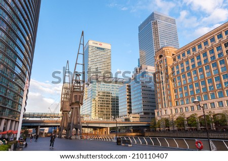 LONDON, UNITED KINGDOM - May 9: HSBC's world Head Quarters building and old port cranes part of the redevelopment around Canary Wharf in the London Docklands on May 9, 2011 in London. - stock photo