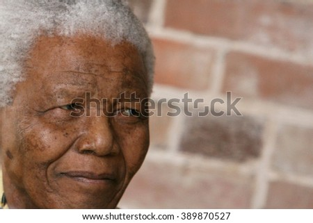 LONDON, UNITED KINGDOM- 24 MAY 2006: Late South African president Nelson Mandela looks on as he poses for a portrait during an event in London.  - stock photo