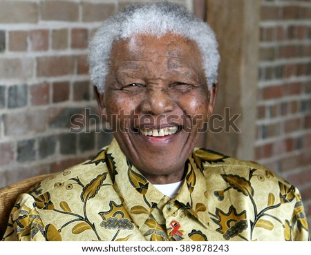LONDON, UNITED KINGDOM- 24 MAY 2006: Late South African president Nelson Mandela smiles as he poses for a portrait during an event in London.  - stock photo