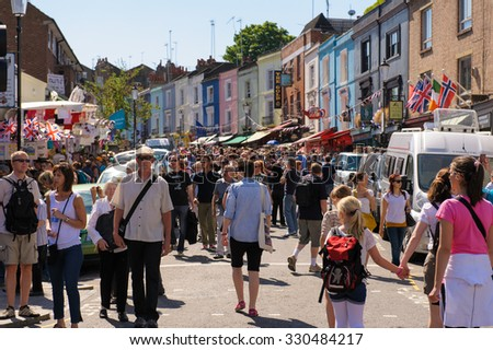 London, United Kingdom - May 26, 2012 : street view of Portobello Market in Notting Hill, London. Its is  the world's largest antiques market with over 1,000 dealers. - stock photo