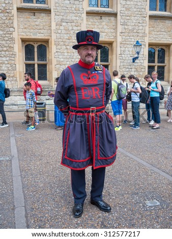 London, United Kingdom - MAY 16, 2015: Yeomen Warders of Tower of London (Beefeaters). Beefeaters are ceremonial guardians of the Tower of London. - stock photo
