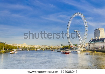 LONDON, UNITED KINGDOM - NOV: London morning with London eye millennium wheel and ferries on November 26, 2013 in London, UK. - stock photo