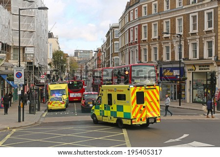 LONDON, UNITED KINGDOM - NOVEMBER 23: Ambulance responder in London on NOVEMBER 23, 2013. Ambulance emergency van at street in London, United Kingdom. - stock photo