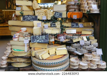 LONDON, UNITED KINGDOM - NOVEMBER 20: Cheese shop in London on NOVEMBER 20, 2013. A variety of cheeses for sale at Borough Market in London, United Kingdom. - stock photo