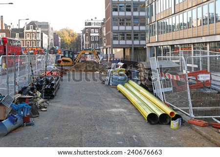 LONDON, UNITED KINGDOM - NOVEMBER 19: Construction site in London on NOVEMBER 19, 2011. Construction site with material and machinery at Paddington in London, United Kingdom. - stock photo