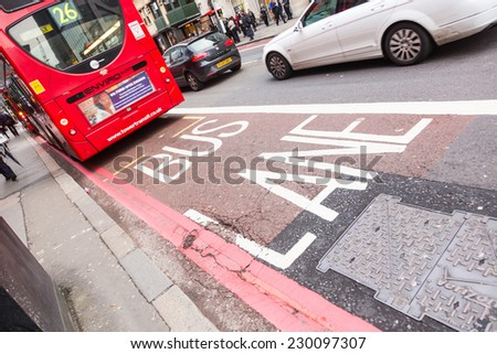 LONDON, UNITED KINGDOM - NOVEMBER 01, 2013: Famous red Double-Decker at bus stop in Liverpool street - stock photo