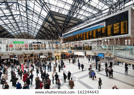 LONDON, UNITED KINGDOM - OCTOBER 20: Commuters inside Liverpool Street Station on October 20, 2013 in London, UK. The annual rail passenger usage between 2011 - 2012 was 13.835 million.  - stock photo