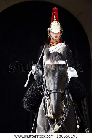 LONDON, UNITED KINGDOM - OCTOBER 14 2013 : Guard on horse at Buckingham Palace in London, England - stock photo