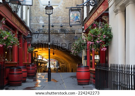 LONDON, UNITED KINGDOM - OCTOBER 7, 2014:  Quaint arched pedestrian walkway at Charing Cross in London, England.   - stock photo