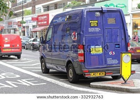 LONDON, UNITED KINGDOM - OCTOBER 09, 2010: Security Van For Money Transport. Parket Armoured Vehicle in Central London, England. - stock photo