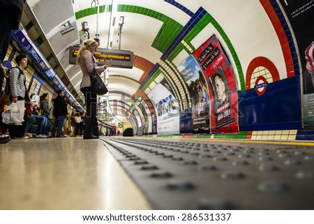 LONDON, UNITED KINGDOM - OCTOBER 8, 2014:  View of subway platform in the London Underground on the Piccadilly Circus Line - stock photo