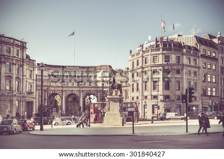 LONDON, UNITED KINGDOM - OCTOBER 7, 2014:  Vintage filter effect image of London street scene at the Admiralty Arch. - stock photo