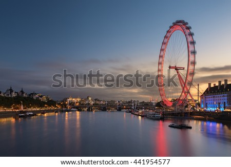 LONDON, UNITED KINGDOM - Sep 8 2015: London at twilight.London eye motion on September 8, 2015 in London, United Kingdom is the tallest Ferris wheel in Europe at 135 meters. - stock photo