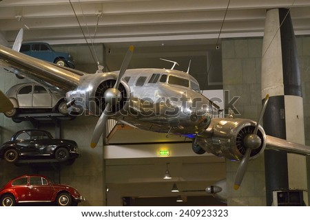 London, United Kingdom September 5, 2013: Lockheed 10A Electra serial no 1037, made in 1935, hangs on display. The Electra is the plane in which Amelia Earhart disappeared on July 2, 1937. - stock photo