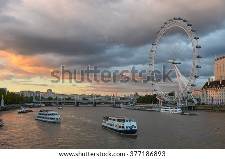 London, United Kingdom - September 12, 2015 : The London Eye is a giant wheel on the River Thames in London, also known as the Millennium Wheel, which opened to the public on 1 February 2013 - stock photo